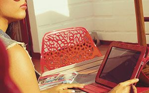 woman on red laptop