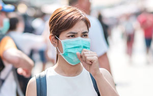 woman with face mask in crowd